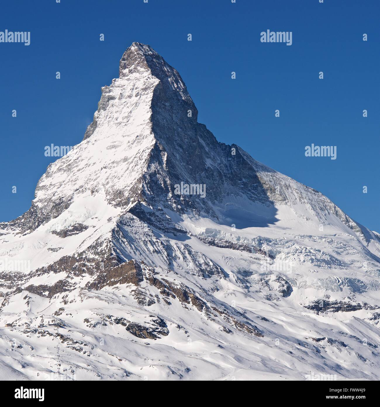 A colour image of the peak of the snow covered matterhorn - Stock Image
