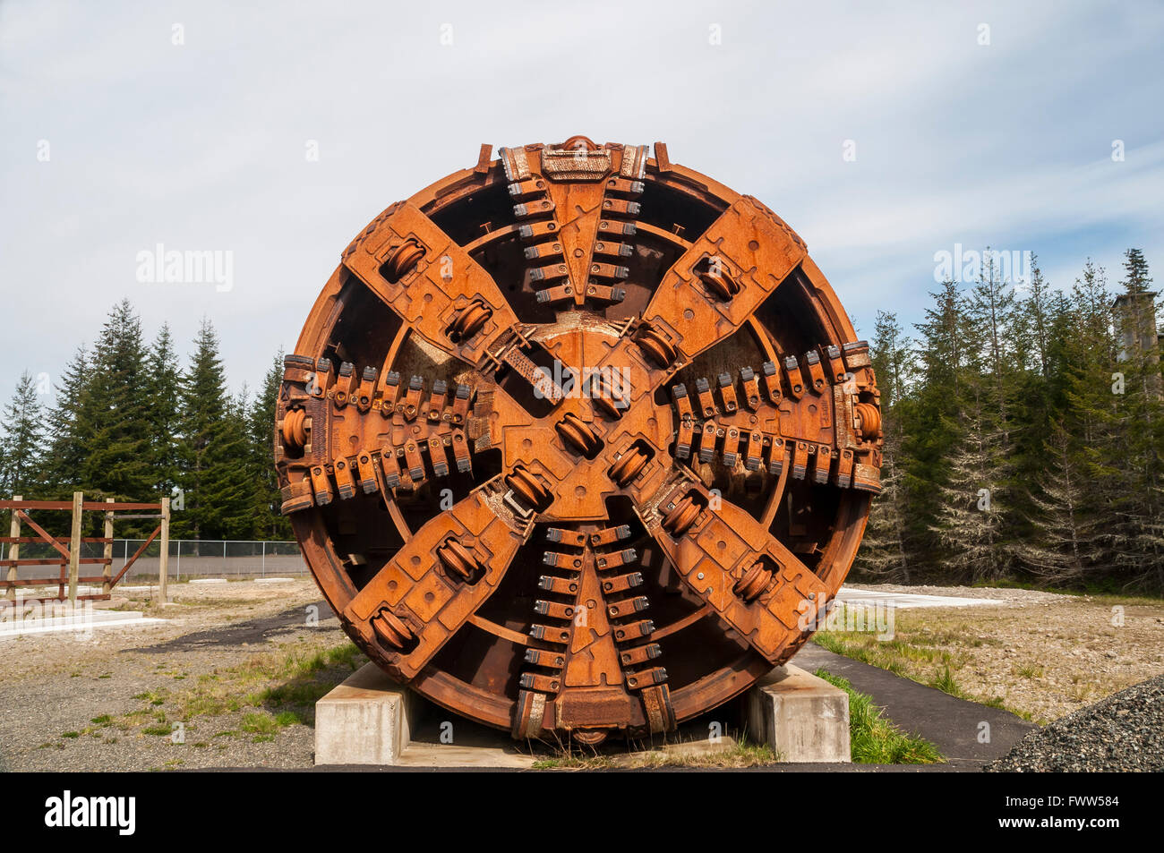Horizontal image of a rusty tunnel boring machine cutter head. - Stock Image
