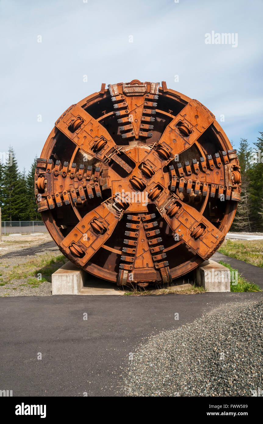 Vertical image of a rusty tunnel boring machine cutter head. - Stock Image