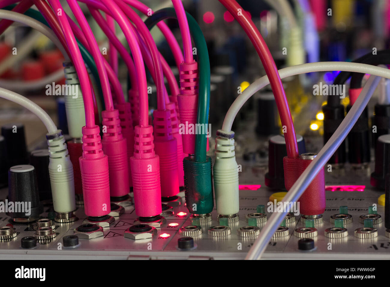 audio cables in music studio - modular synthesizer, analogue synth closeup - Stock Image