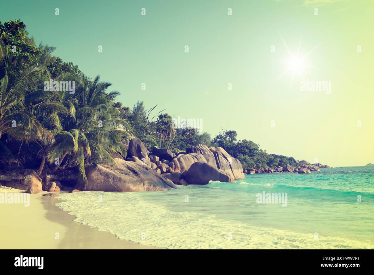 sunny vintage filtered anse lazio praslin island seychelles - Stock Image
