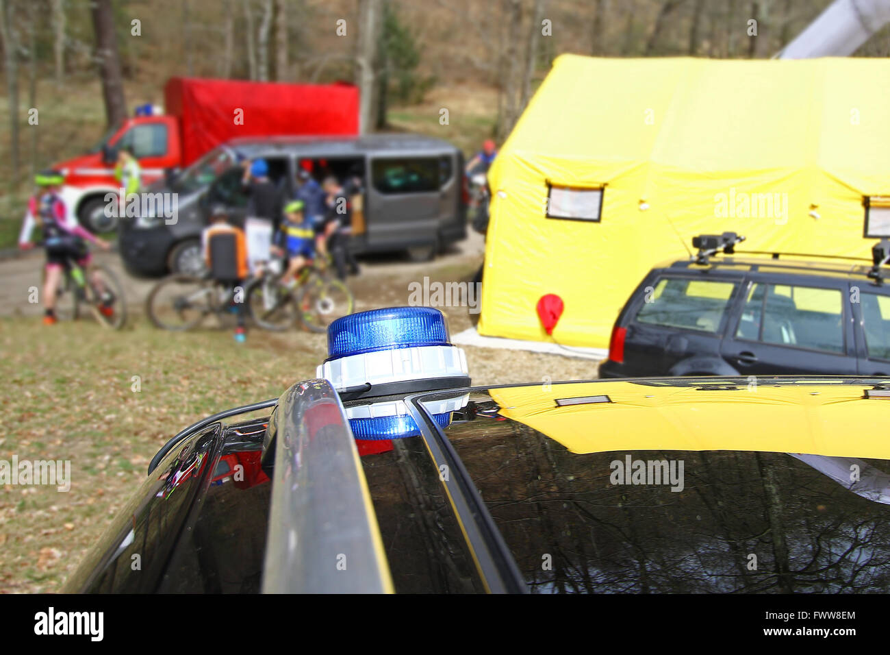 Medical care tent and vehicles at a mountain bike event - Stock Image
