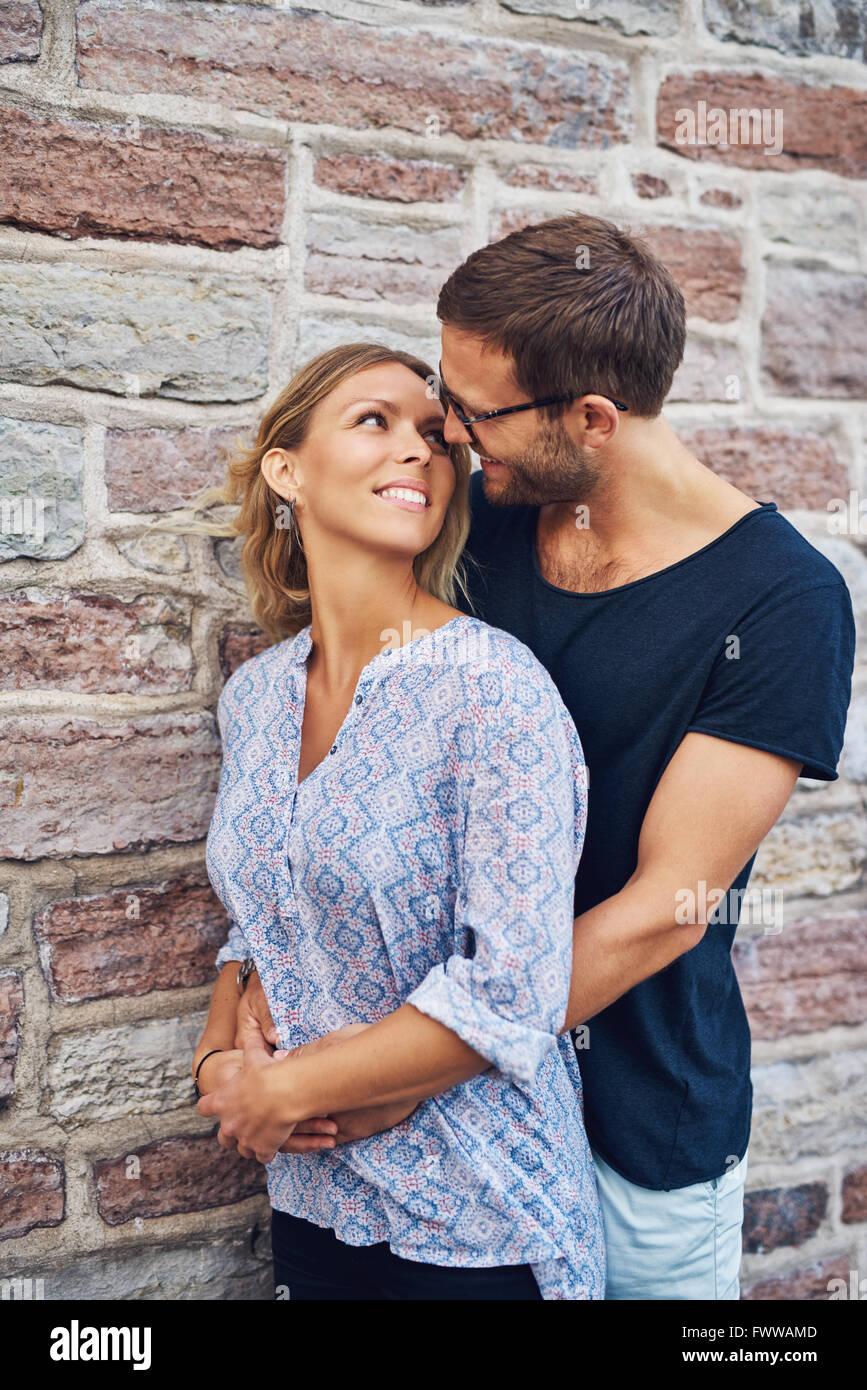 man hugging woman from behind
