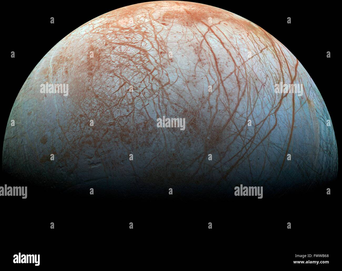 Jupiter's icy moon Europa looms large in this newly-reprocessed color view made from images taken by NASA's - Stock Image