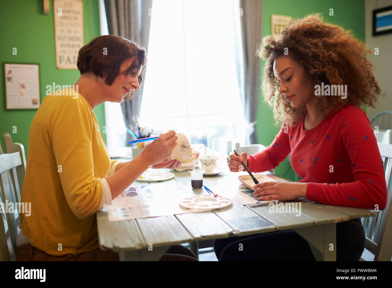 Two Women In Ceramic Painting Class - Stock Image