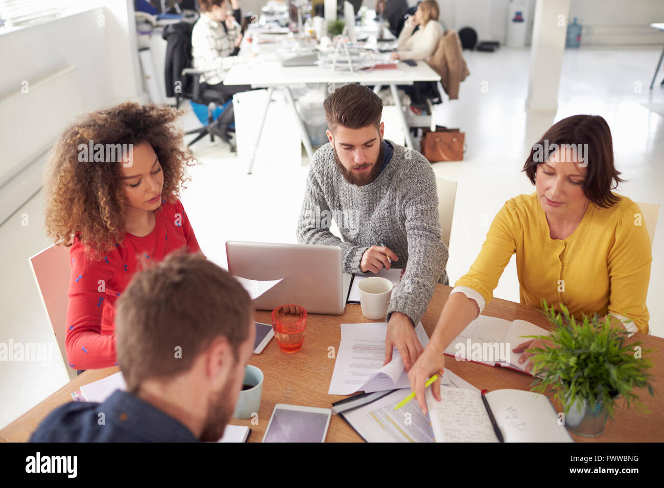 High Angle View Of Business Meeting In Modern Busy Office - Stock Image