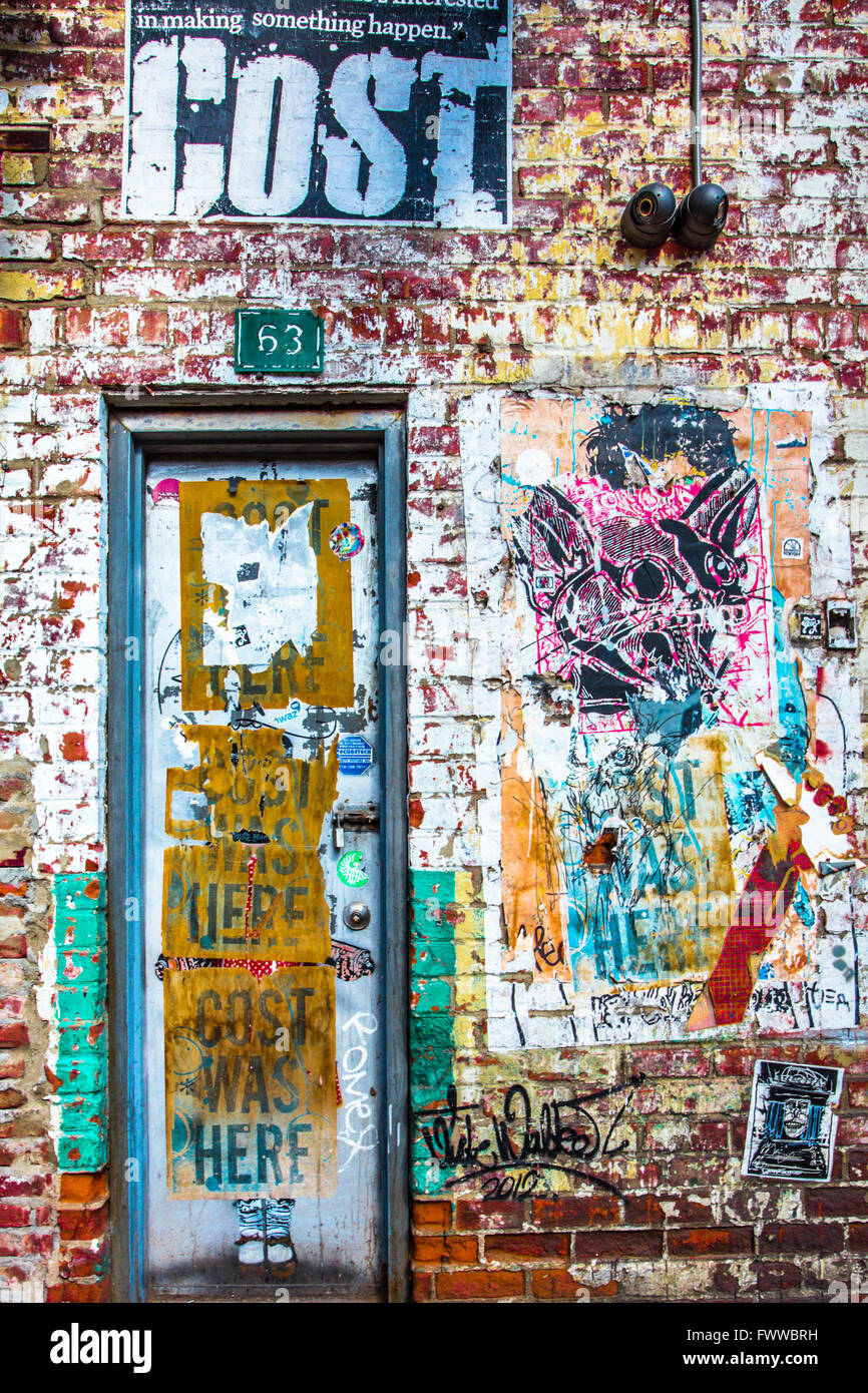 Grunge door in new york city on building exterior covered in graffiti
