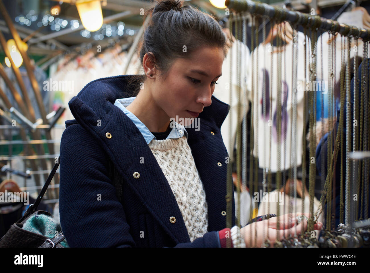 Young Woman Shopping In Covered Market Stock Photo
