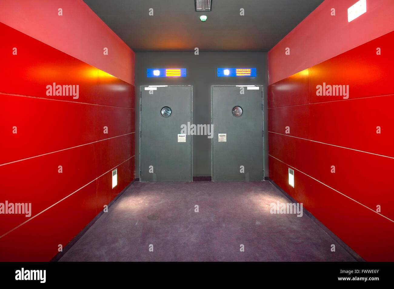 Two doors in a red corridor cinema room. Horizontal & Two doors in a red corridor cinema room. Horizontal Stock Photo ...