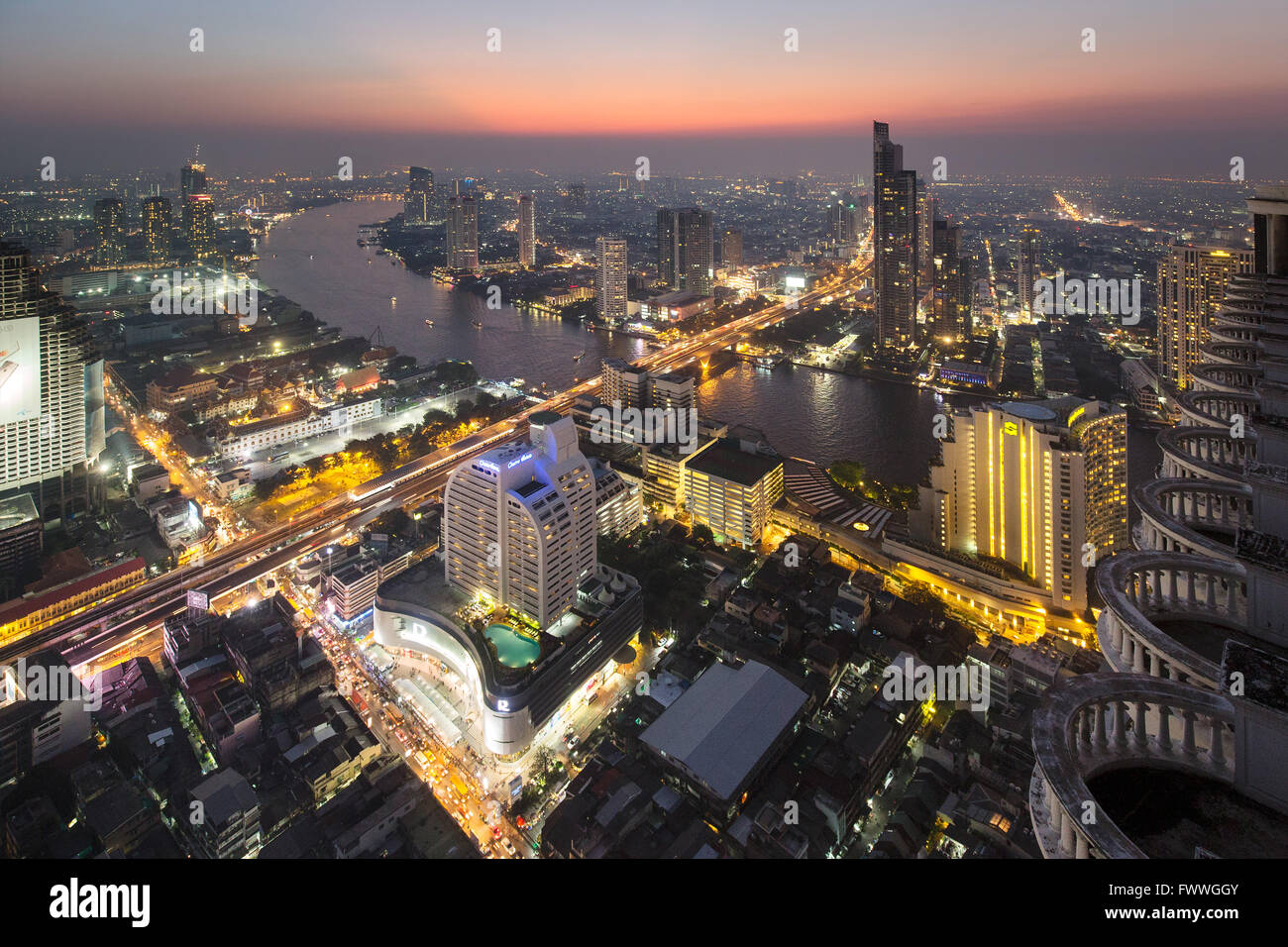Panoramic view from the Sky Bar of the Lebua State Tower, Chao Phraya river, bridge to Khlong San district, dawn - Stock Image