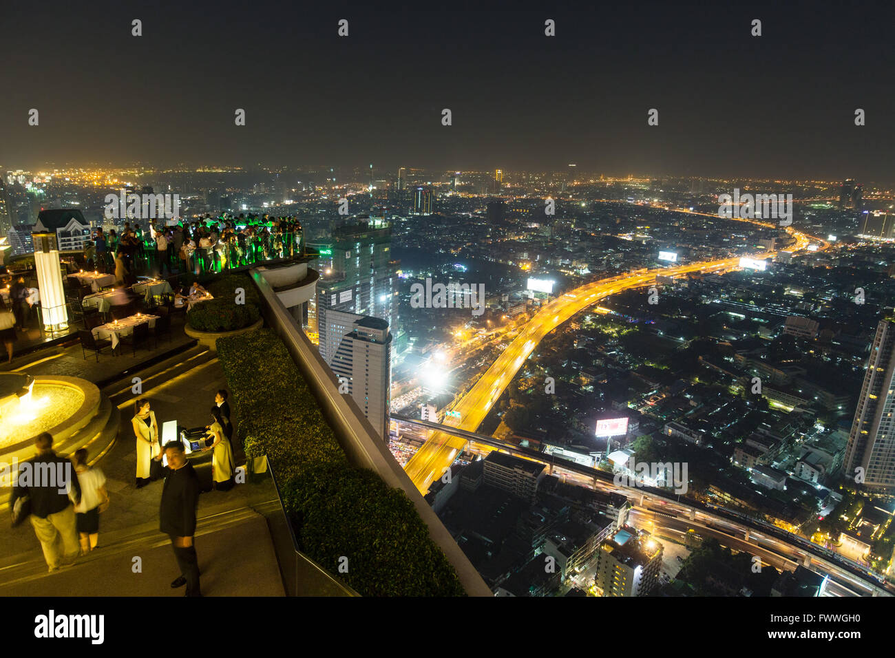 Guests at the Sky Bar on the Lebua State Tower with panoramic views, night shot, Bang Rak district, Bangkok, Thailand Stock Photo