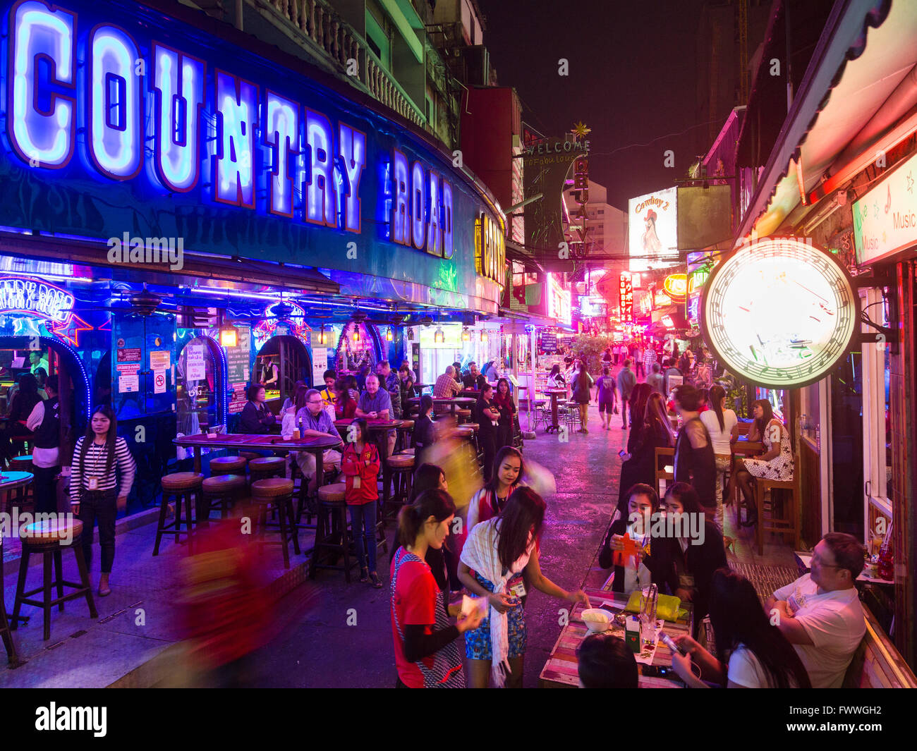 Country Road Music Pub, nightly street scene in the red light district with many bars, Asoke, Sukhumvit, Bangkok, - Stock Image