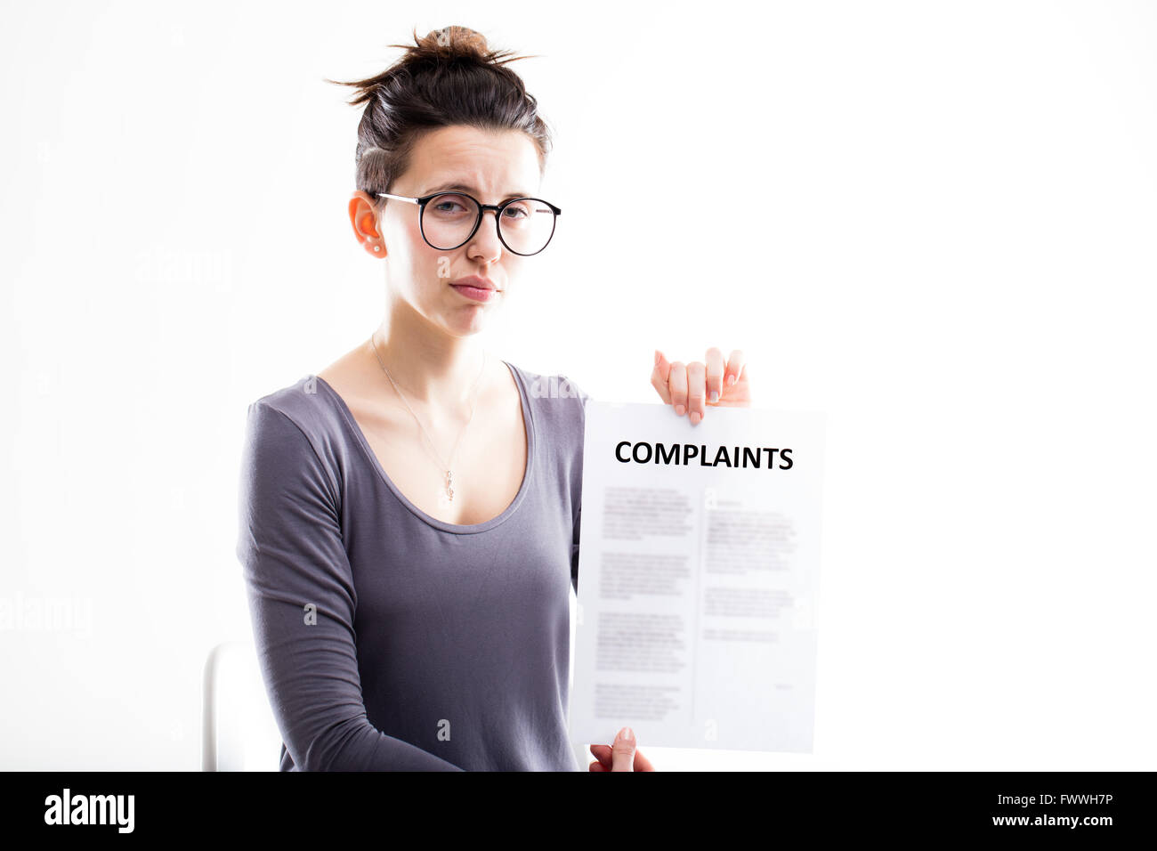 sad woman showing just received complaints and thinking what to do to solve the problem - Stock Image