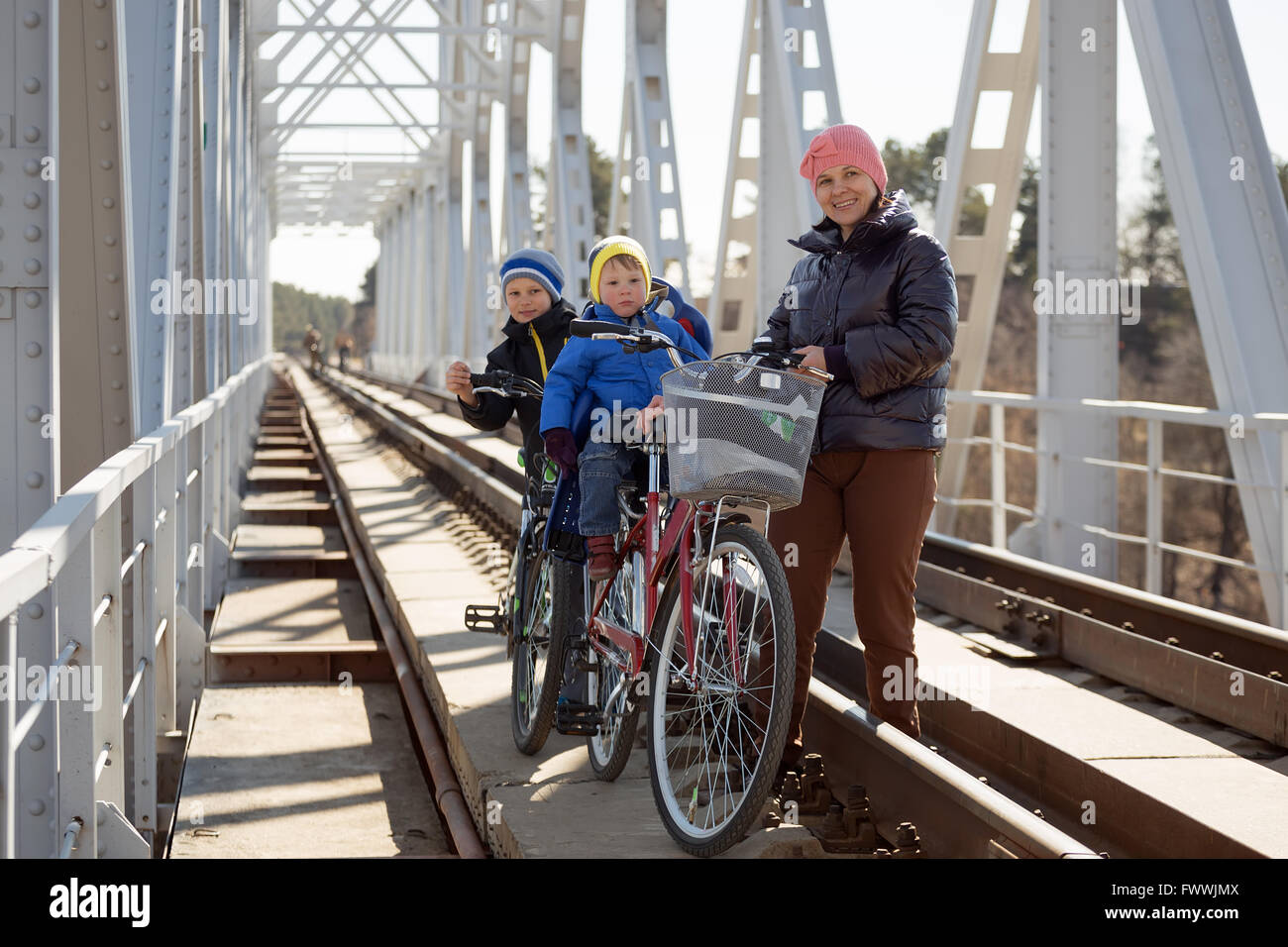 a family of 4 to ride a bike Stock Photo