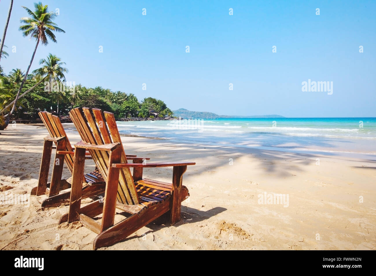 summer tropical holidays, beach hotel in sunny day, vacations on paradise island, background with place for text - Stock Image