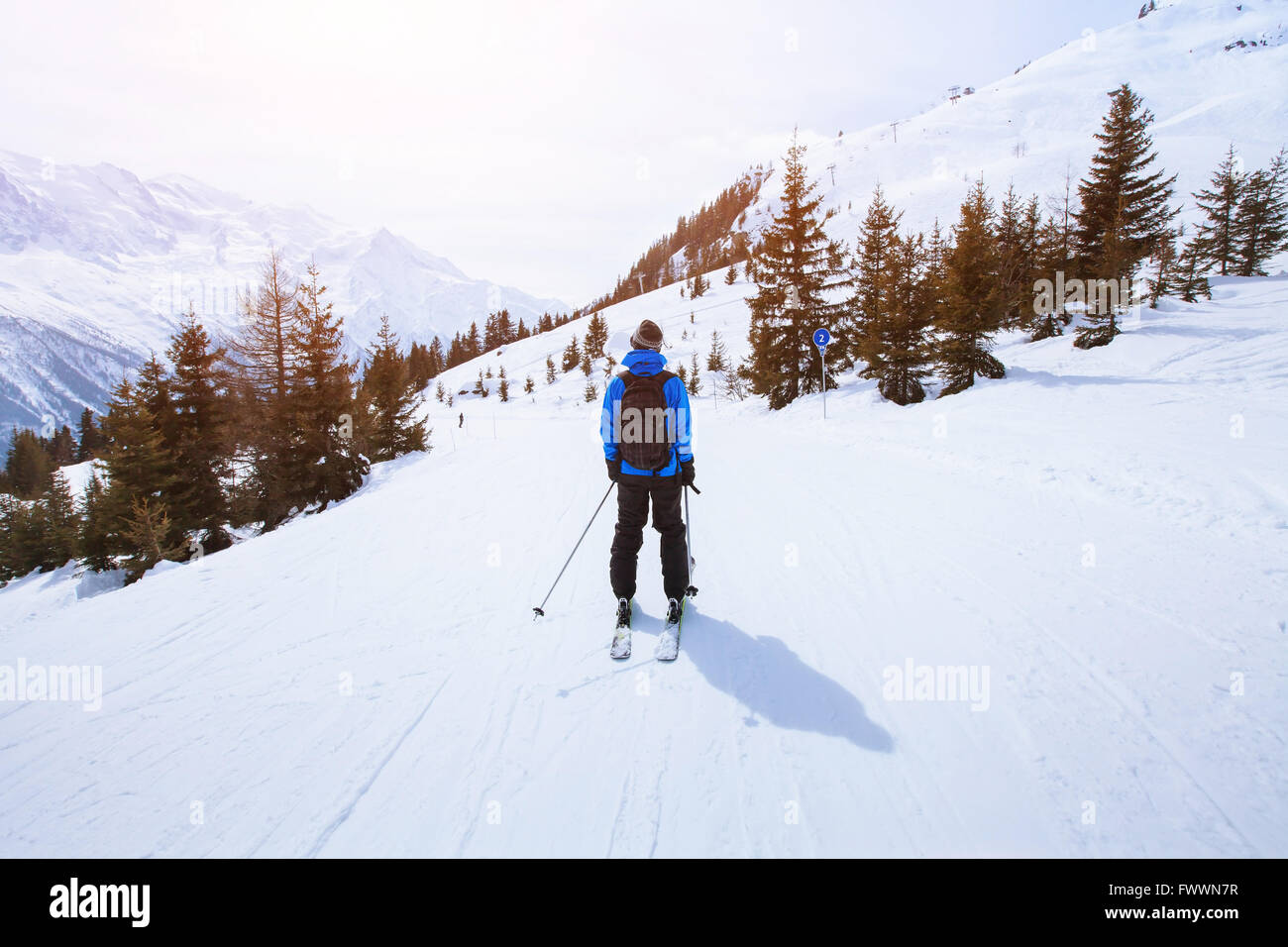 skiing in Alps, winter sport in mountains, skier and beautiful landscape - Stock Image