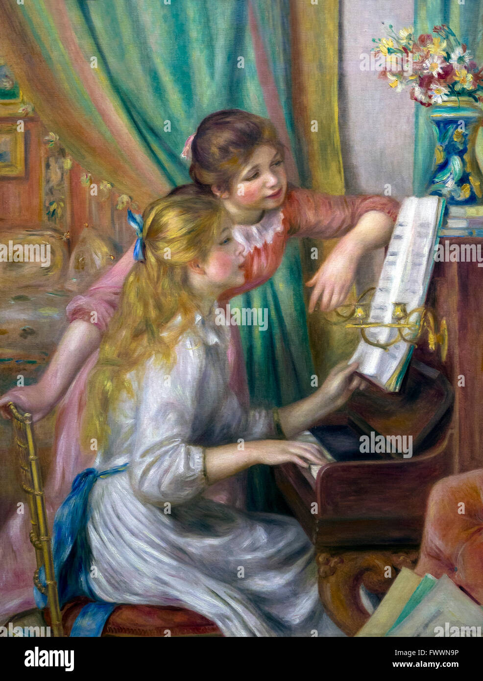 Young women at the piano, Jeunes filles au piano, by Pierre Auguste Renoir, 1892, Musee D'Orsay, Paris, France, - Stock Image