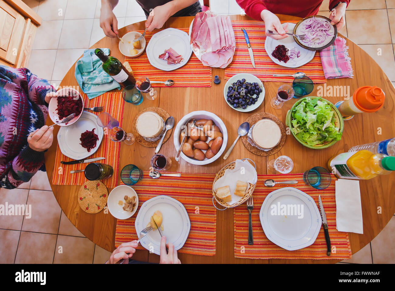 family having lunch at home, top view of the table with food, french cuisine - Stock Image