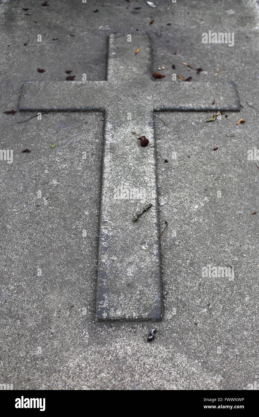 Cross in a granite tombstone - Stock Image
