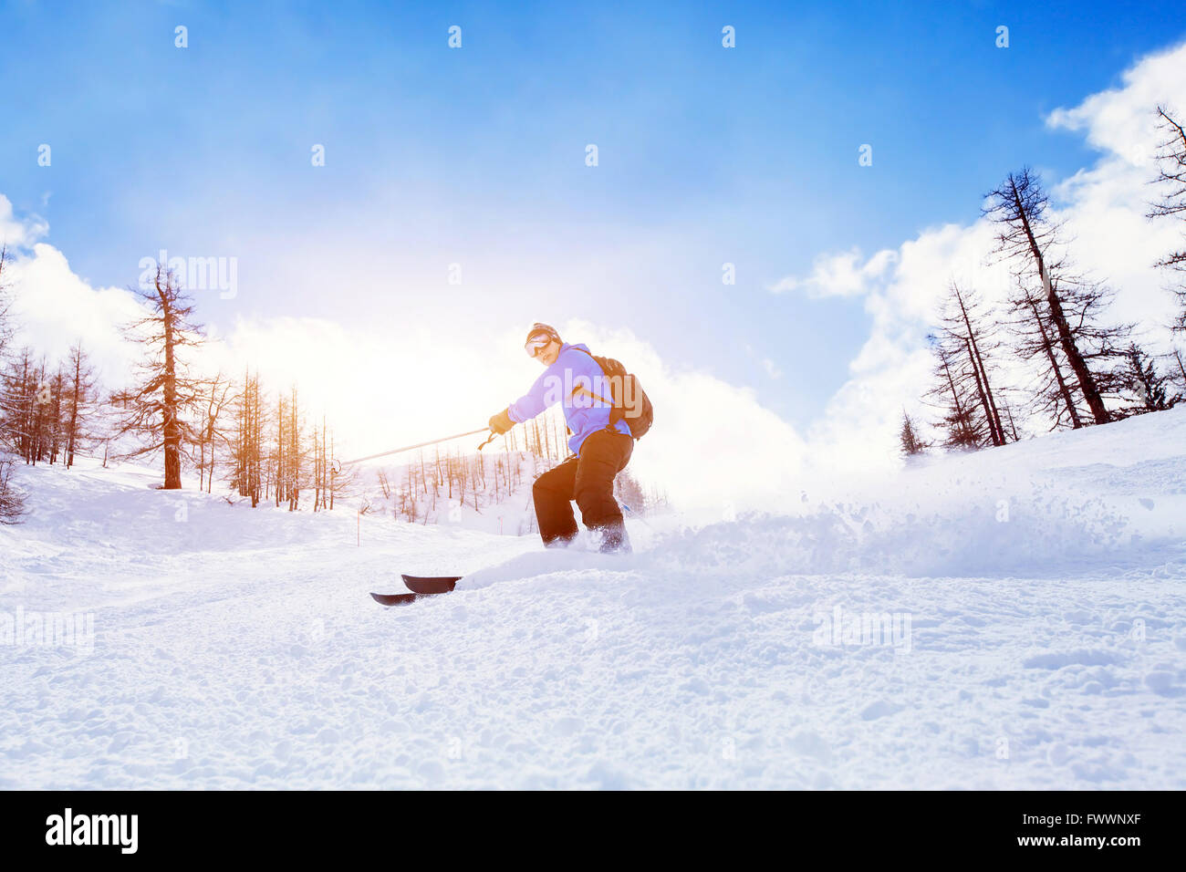 skiing downhill in winter mountains Stock Photo
