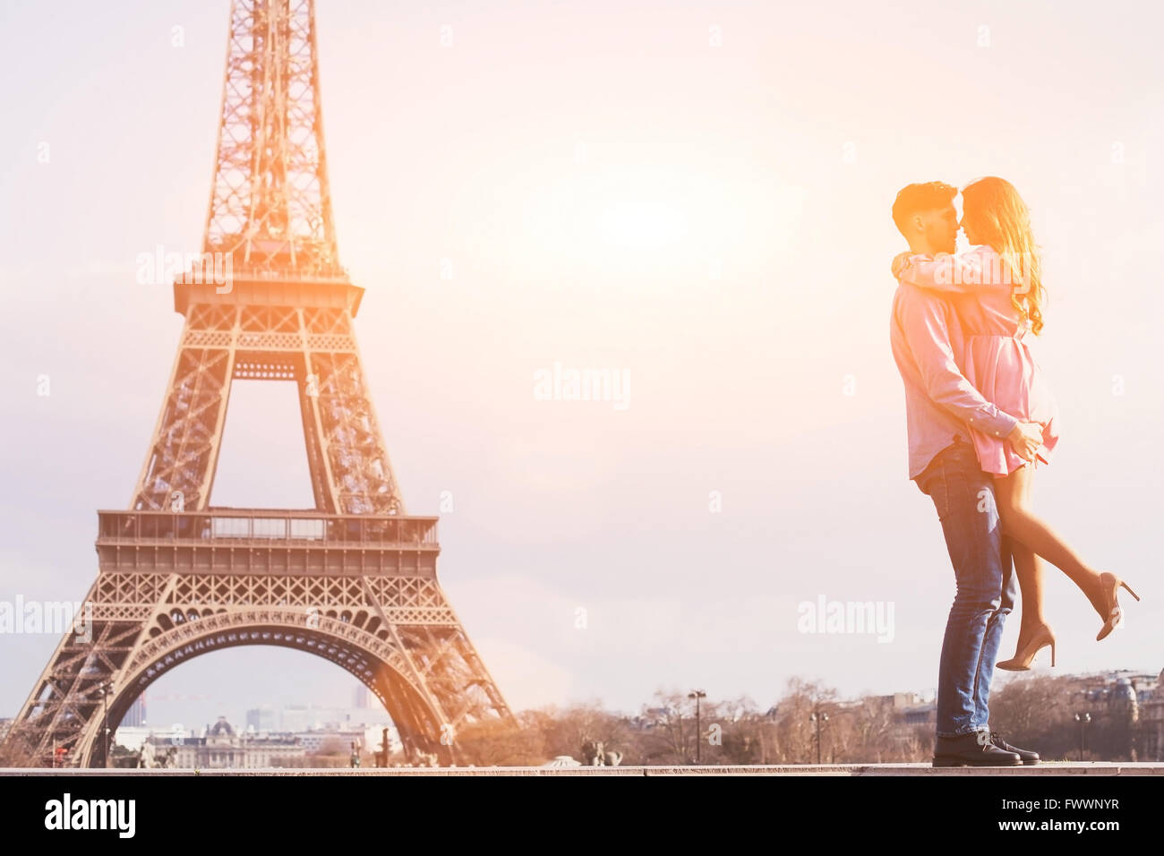love in the most romantic city - Paris, young couple at Eiffel Tower and vanilla sky - Stock Image