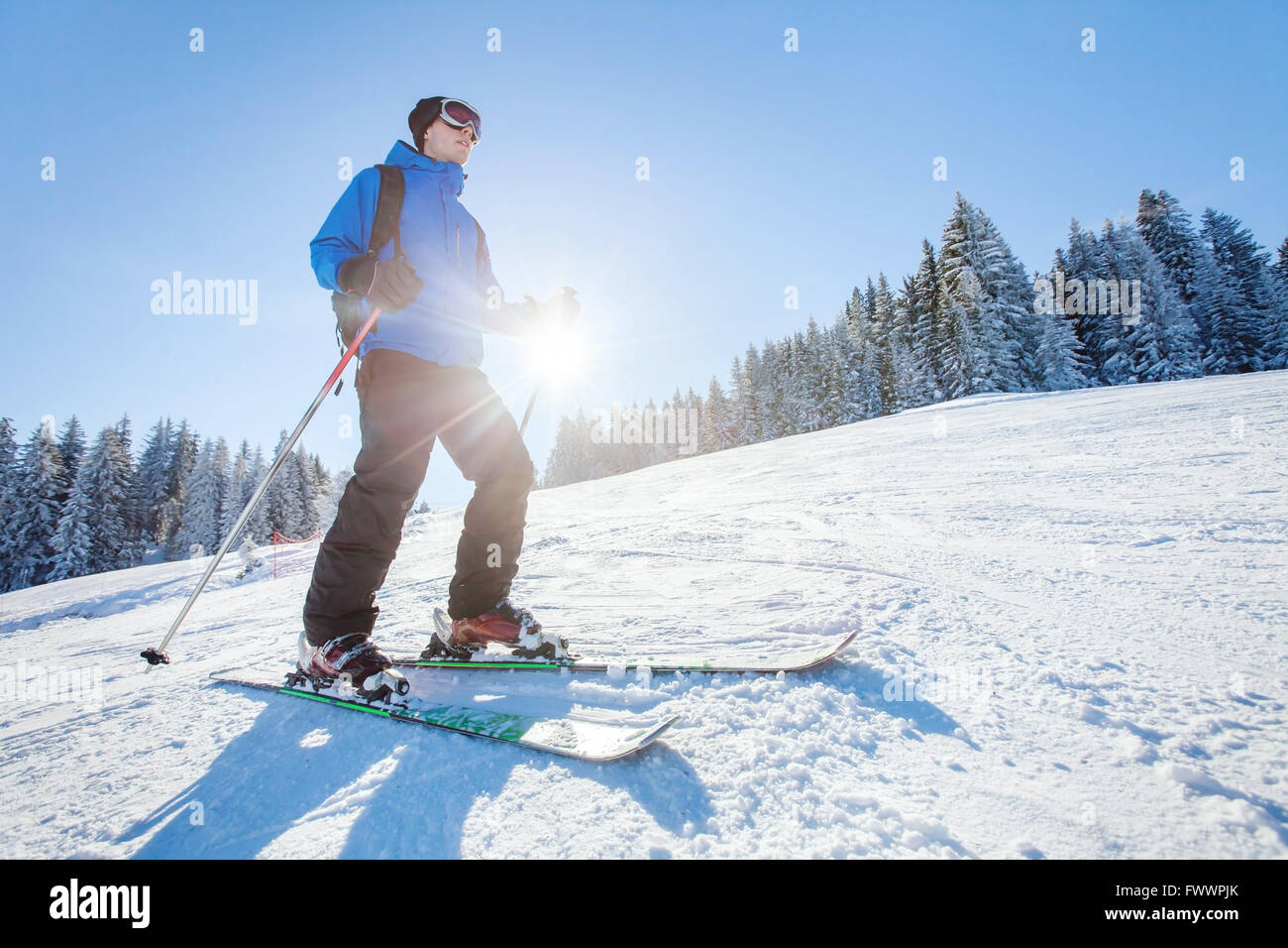 ski in Alps, winter sport, young skier on the slope in sunny day - Stock Image