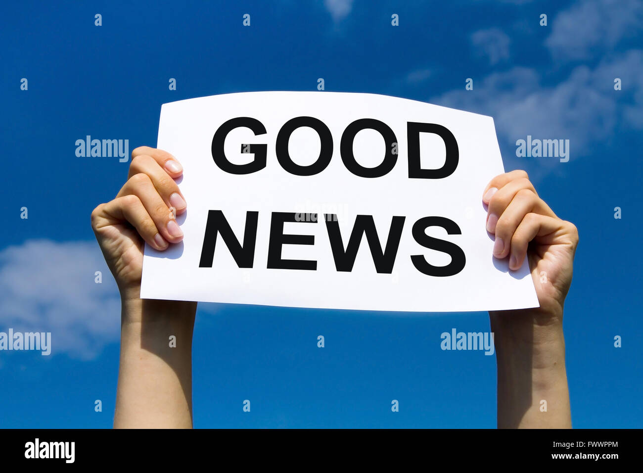 good news, hands holding paper with text concept, positive media - Stock Image