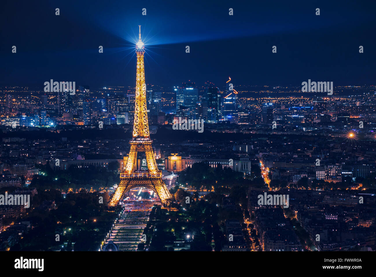 beautiful night scene of illuminated Eiffel Tower and panoramic aerial view of Paris, France - Stock Image