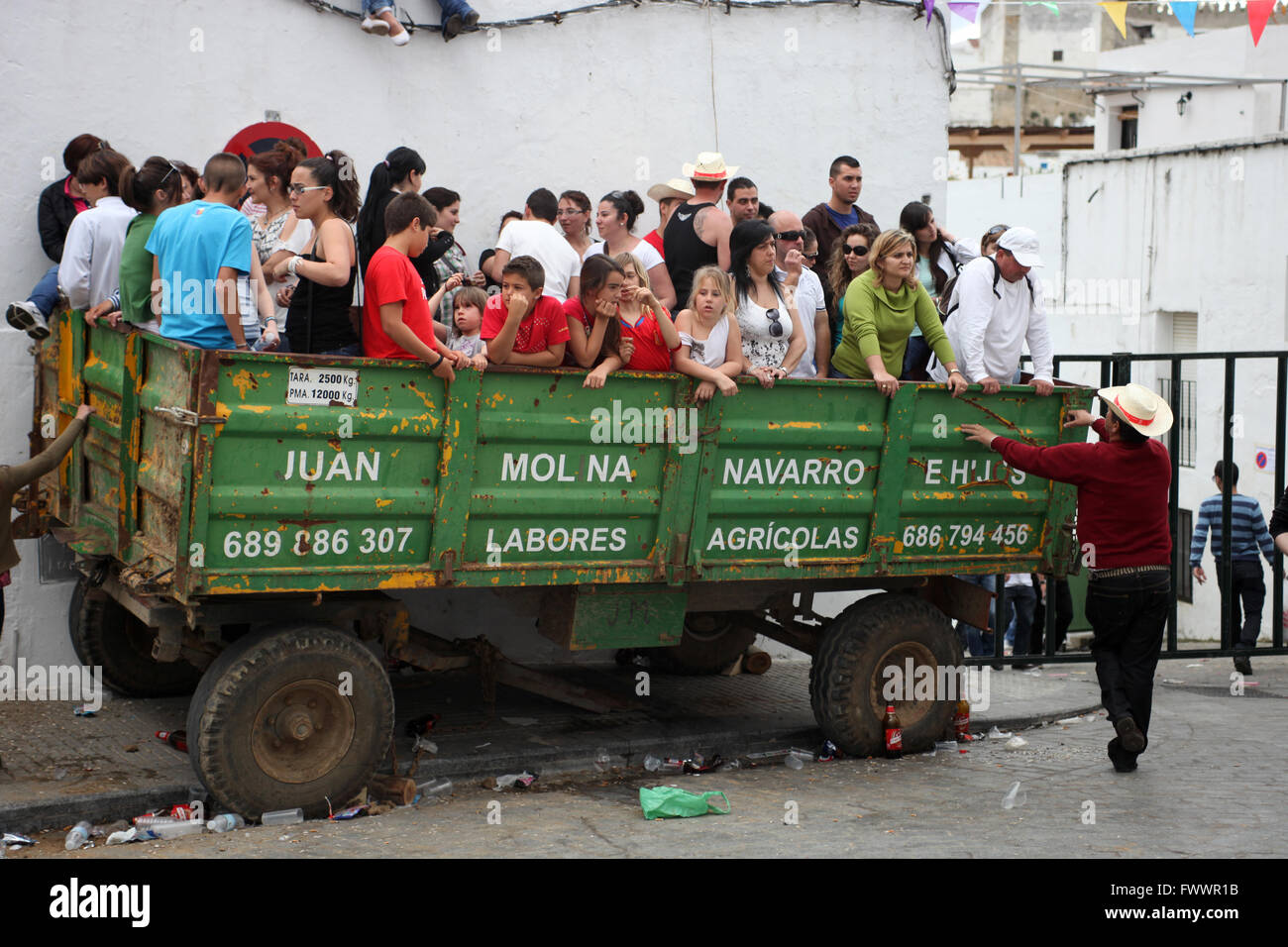 A Man Wearing Cowboy Hat During Easter Party Next To Lorry Full Of People Waiting For Toro Emboli In Vejer De La Frontera C