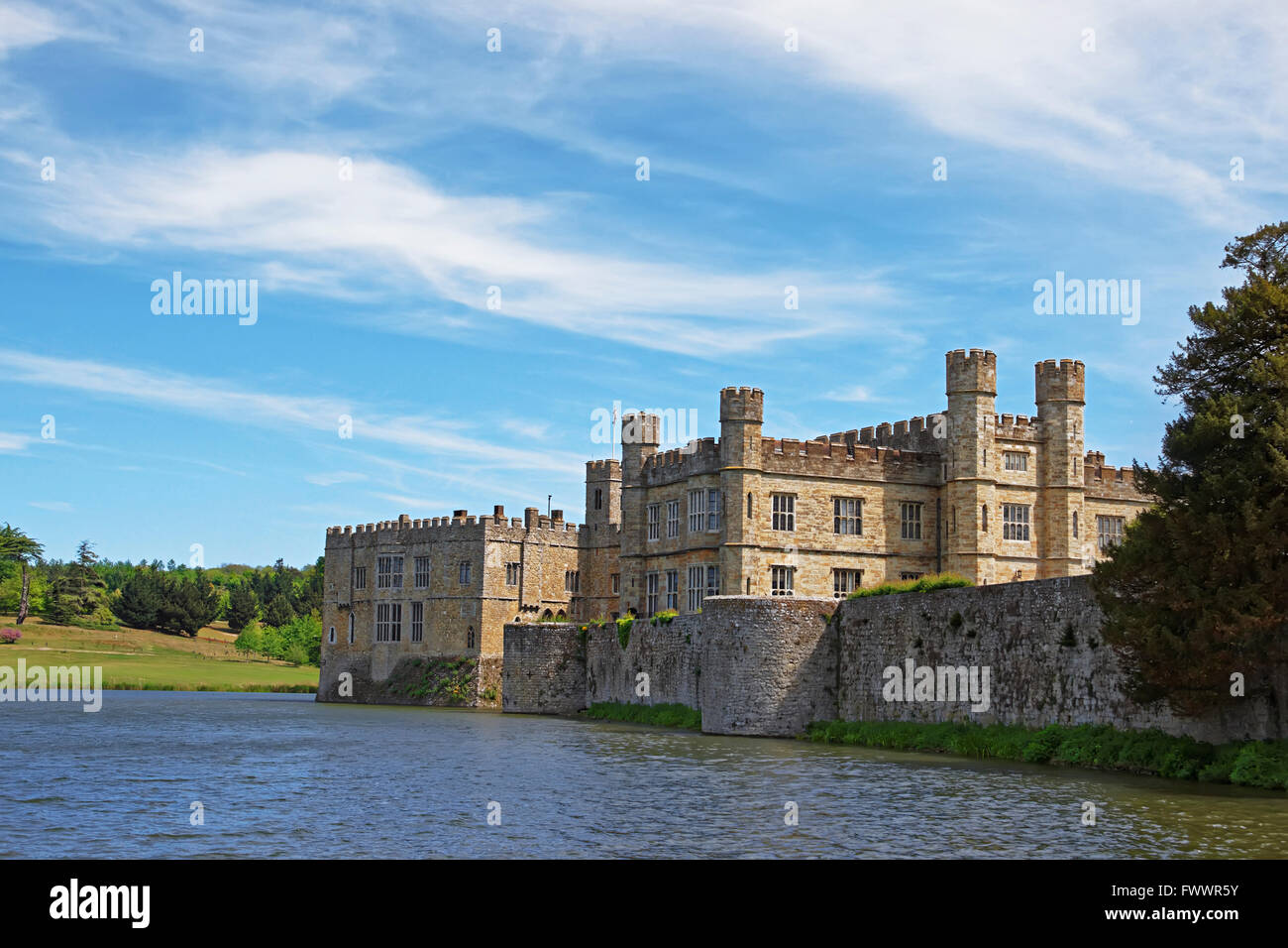 Leeds Castle in a lake in Kent in England. The castle was built in the twelfth century as a king residence. Now - Stock Image
