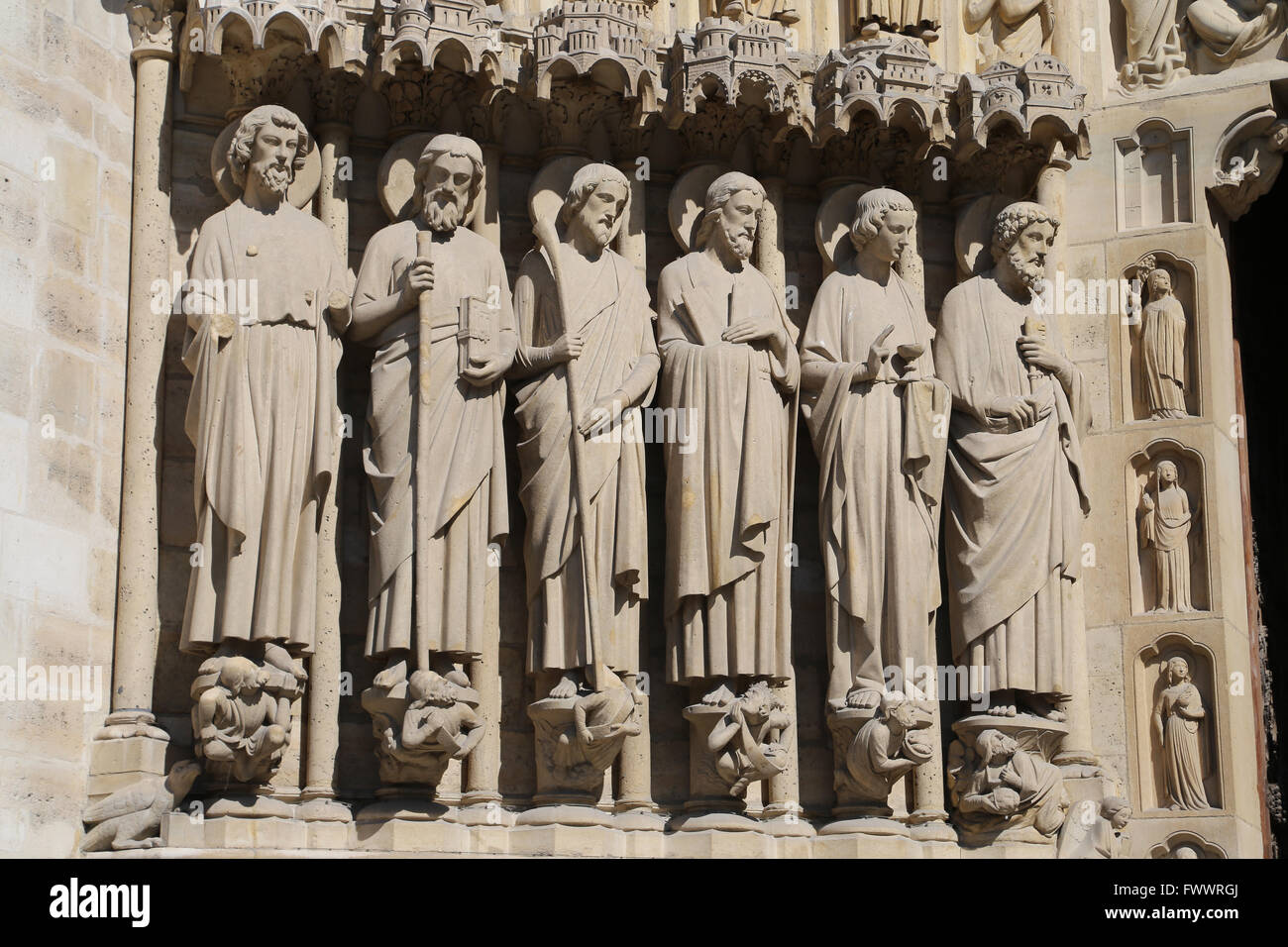 France. Paris. Western facade, Cathedral of Notre-Dame.13th century.  Portal of the Last Judgement, Apostles left. Stock Photo