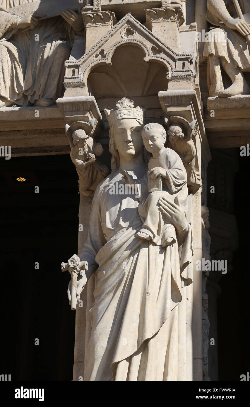 France. Paris.The Western facade, Cathedral of Notre-Dame. Gothic. 13th c. Portal of the Virgin. Virgin with child, - Stock Image
