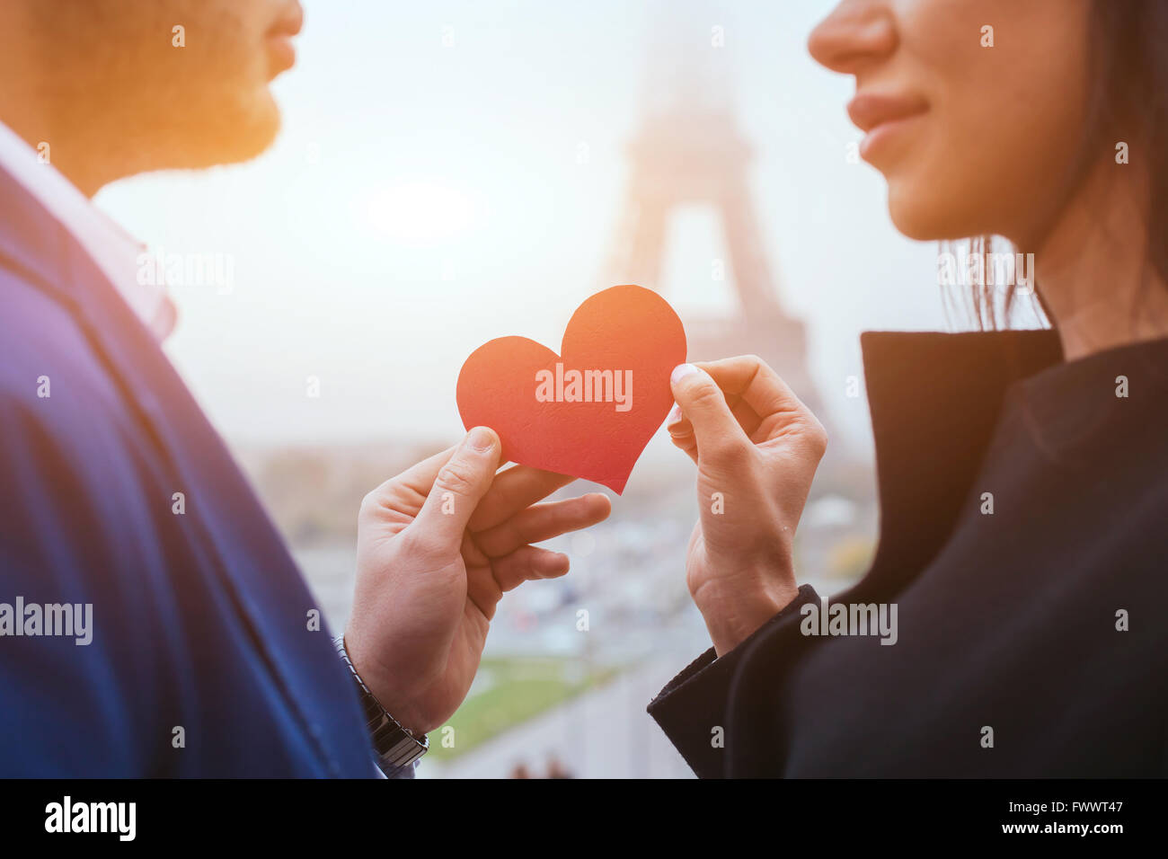 love and romance, couple on honeymoon near Eiffel Tower in Paris, heart for Valentines day - Stock Image