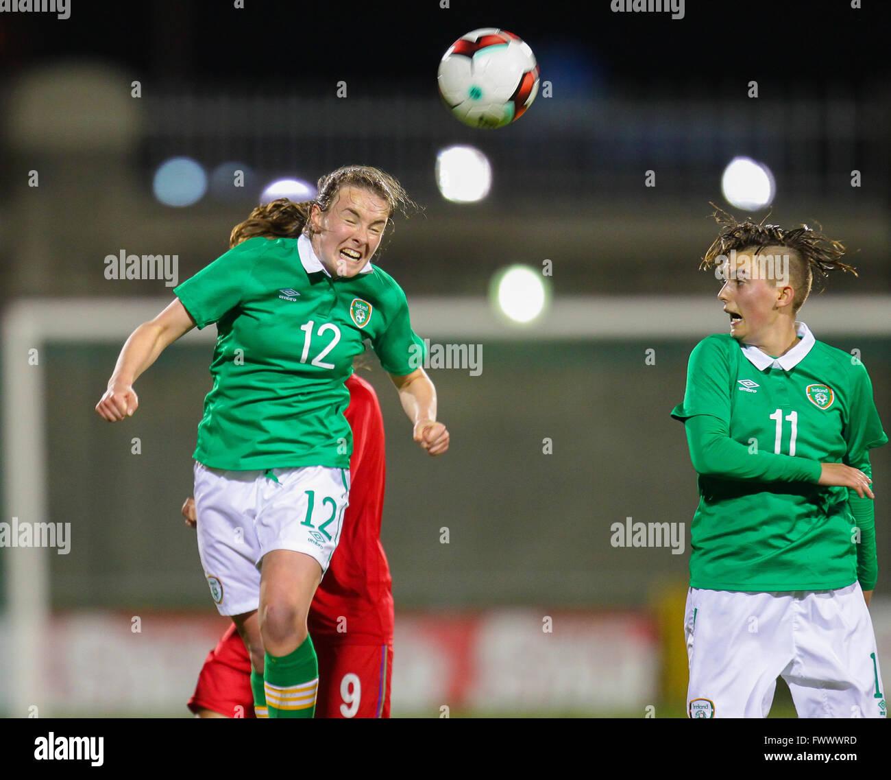 Dublin, Ireland. 7th April, 2016. Lucy McCartan of Ireland U19 wins the header, Ireland Women U19 v Azerbaijan Women - Stock Image