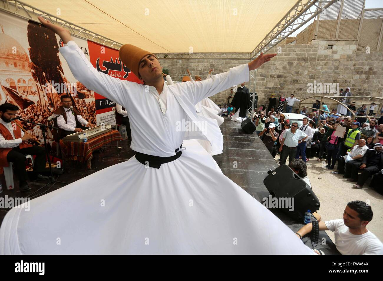 Jericho, West Bank, Palestinian Territory. 8th Apr, 2016. Whirling dervishes perform during a festival at the mosque - Stock Image