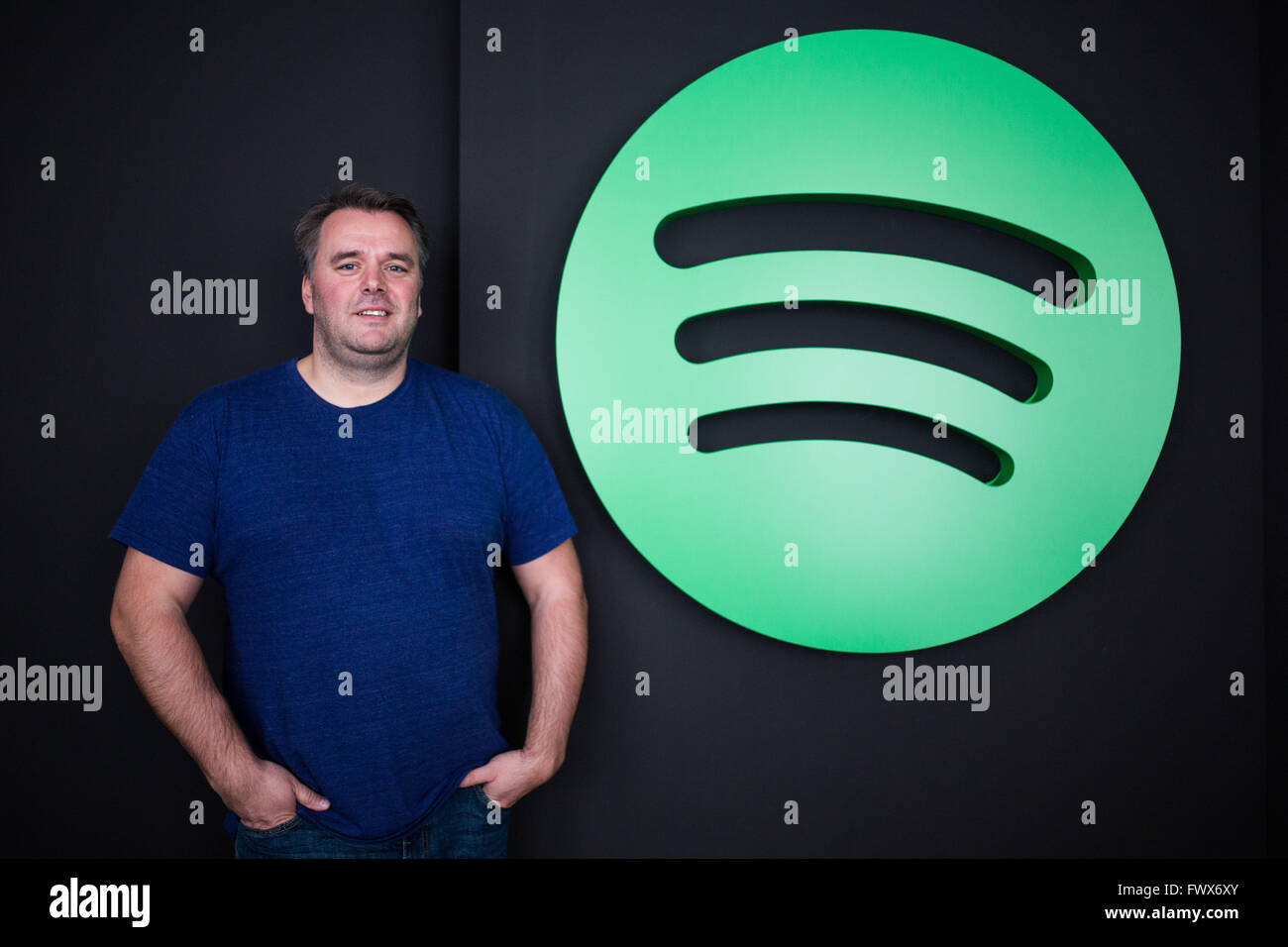 Berlin, Germany. 07th Apr, 2016. Stefan Zilch, CEO of Spotify GmbH, stands in front of the Spotify logo in Berlin, Stock Photo