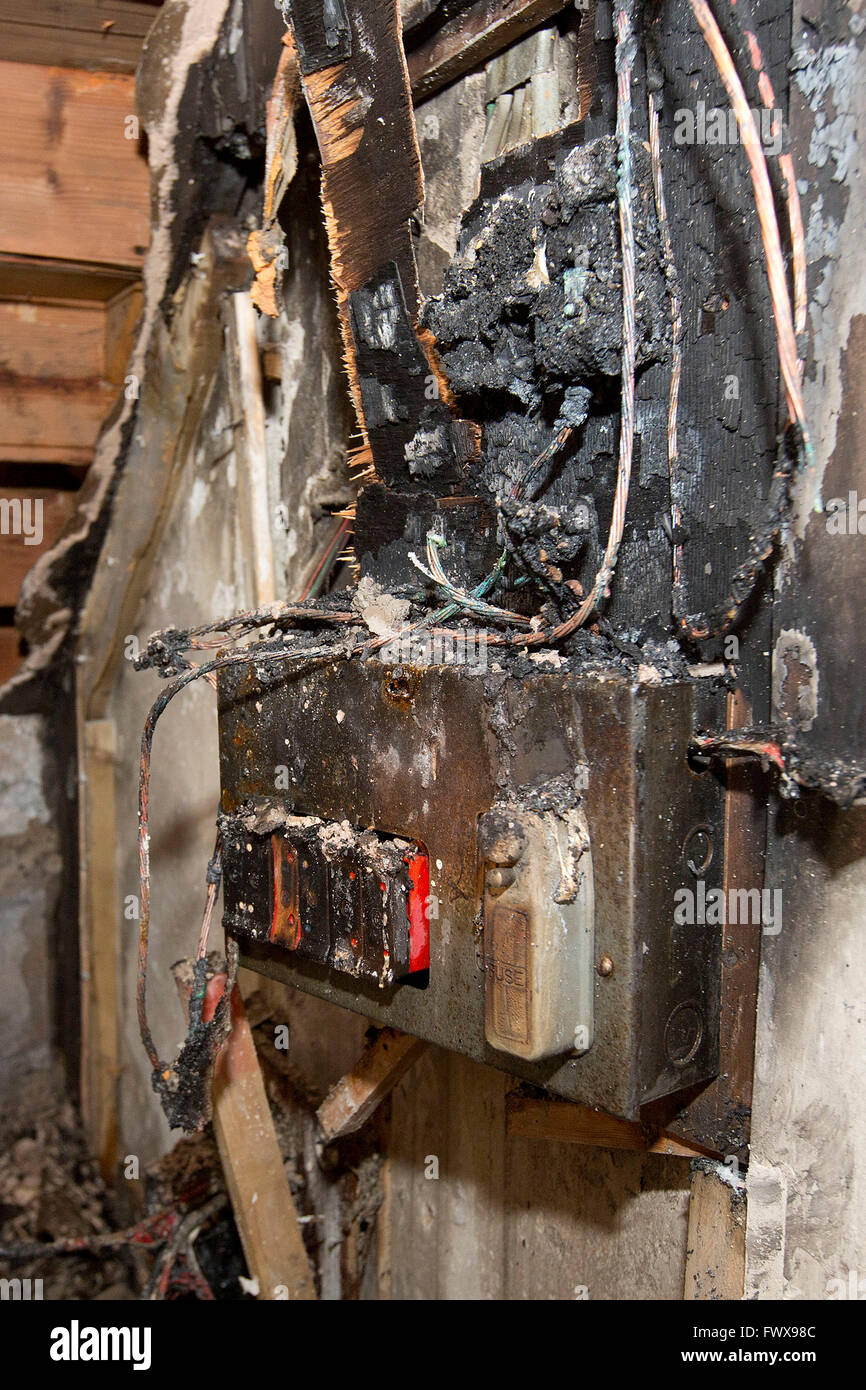 A fusebox in a house which caught fire due to a power surge. - Stock