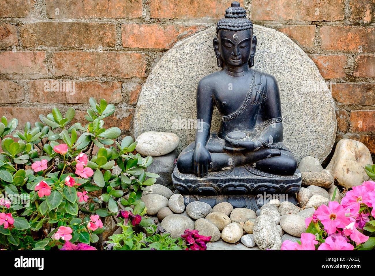 Small Buddha Statue As A Garden Feature Stock Photo Alamy