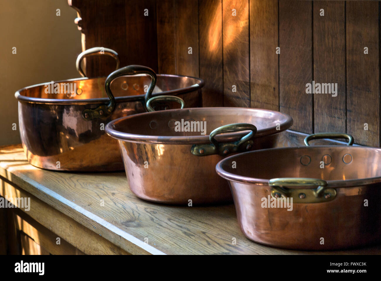 Some of the cooking kitchen utensils  in Penrhyn Castle. - Stock Image