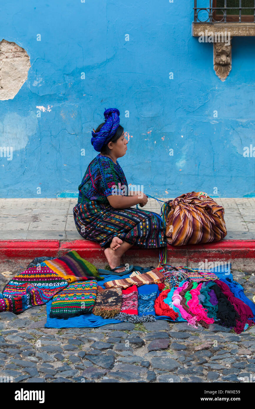 Maya woman selling textiles in Antigua, Guatemala - Stock Image