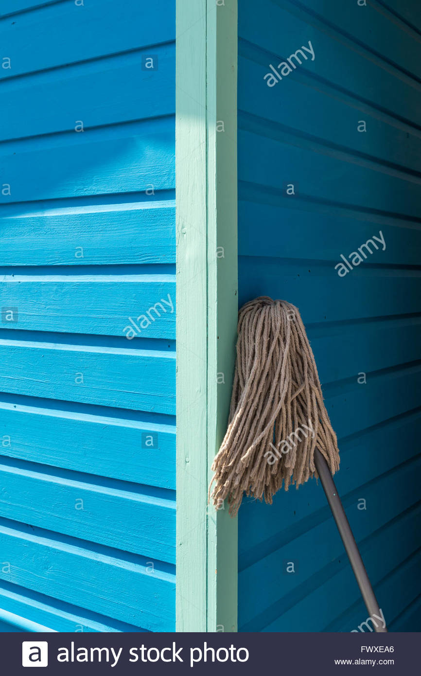 Cleaning mop on a wooden house facade - Stock Image