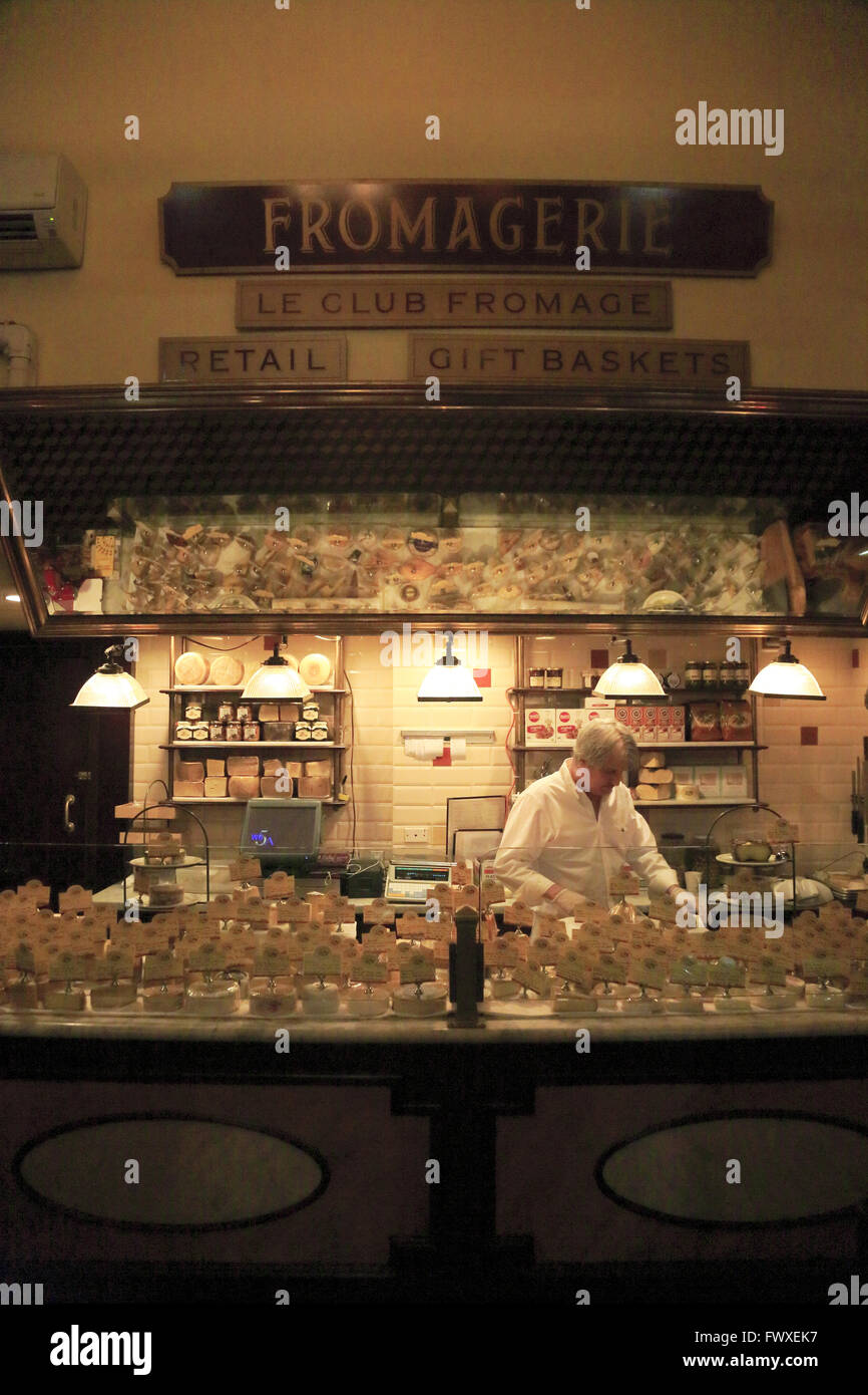 Cheese department selling imported cheese inside of French restaurant Artisanal Fromagerie & Bistro,Manhattan,New - Stock Image