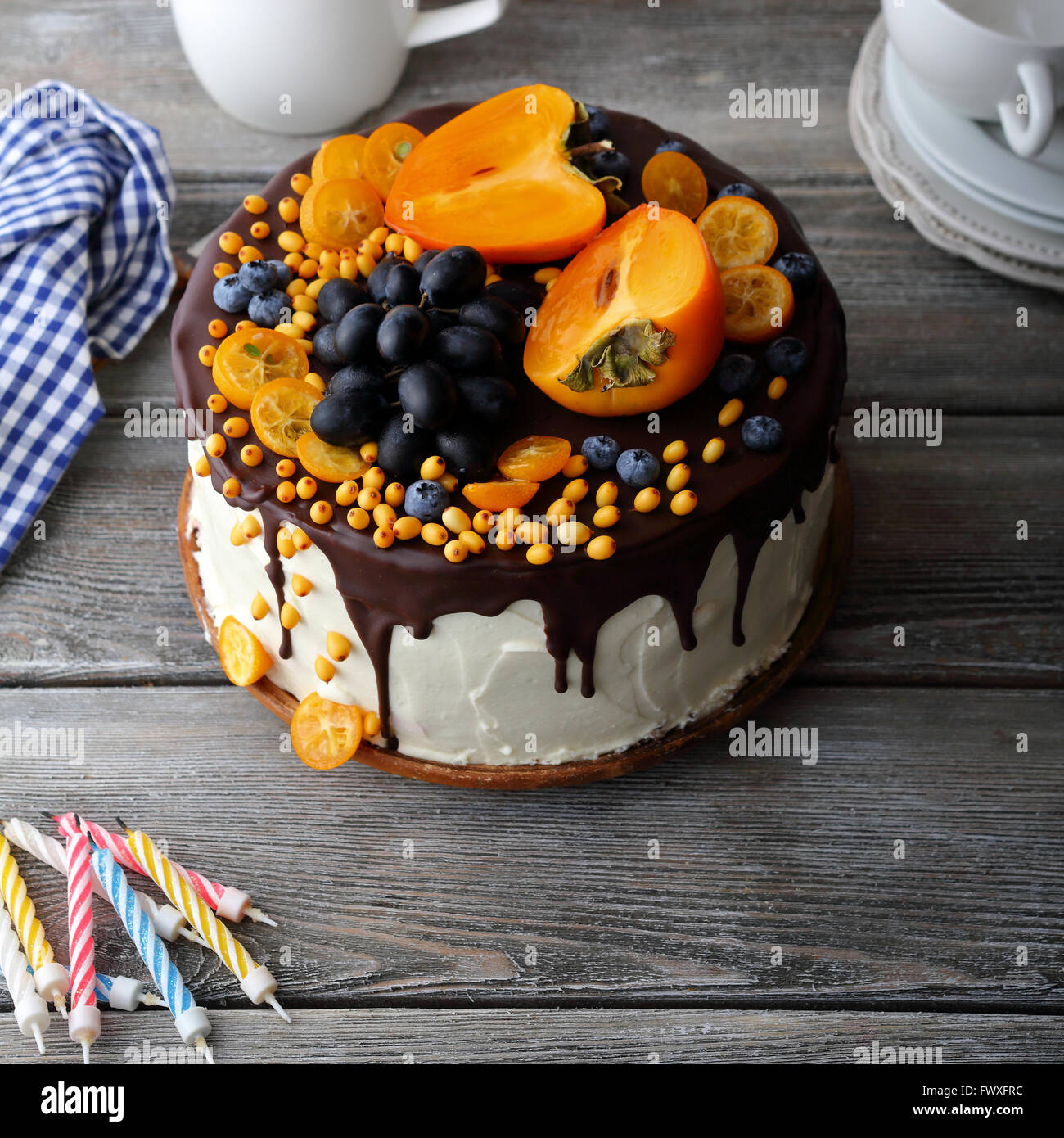 fruit cake on rustic boards, food closeup - Stock Image