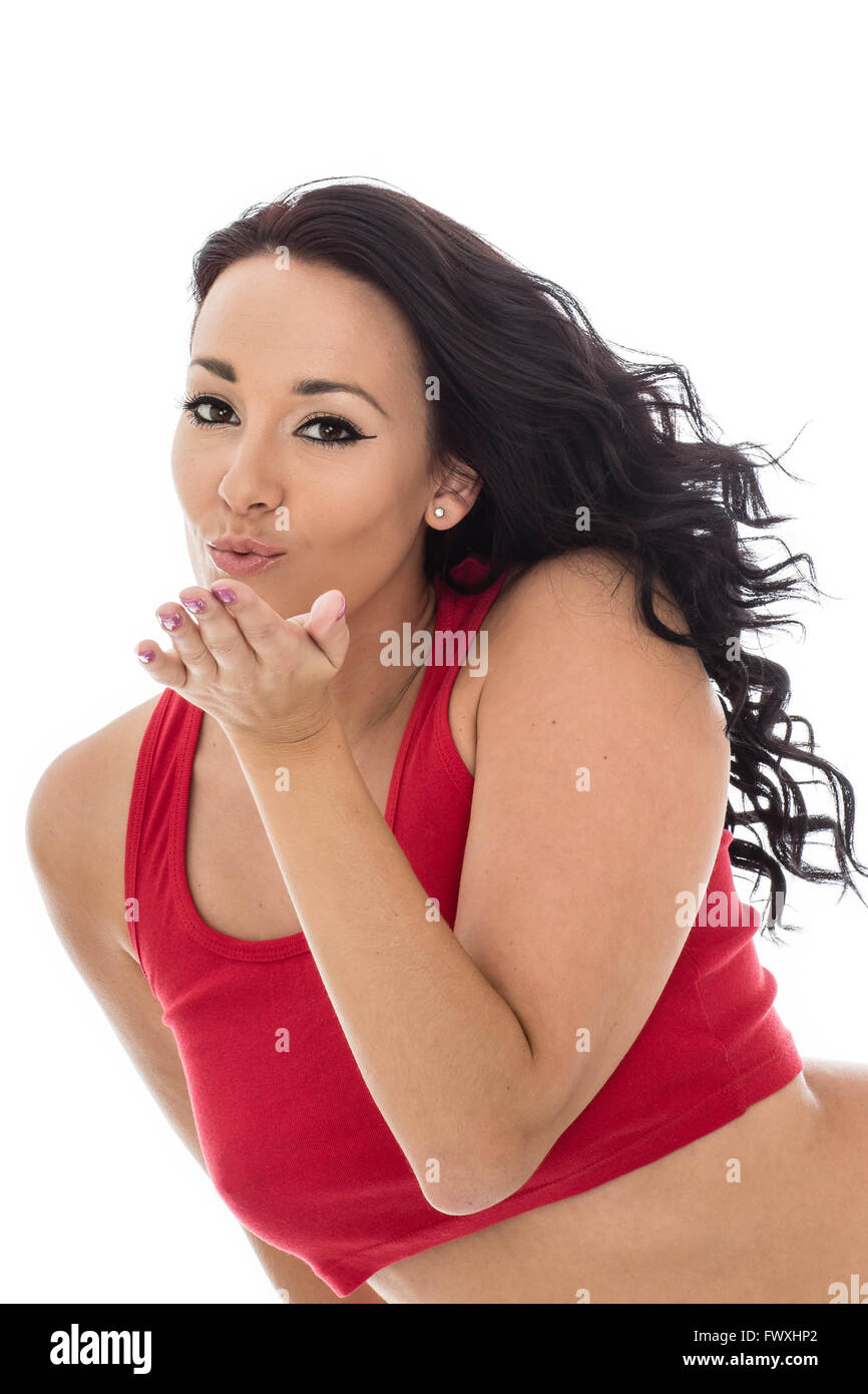 Attractive Happy Young Hispanic Woman Wearing A Red Vest Top Isolated Against A White Background Blowing A Kiss - Stock Image