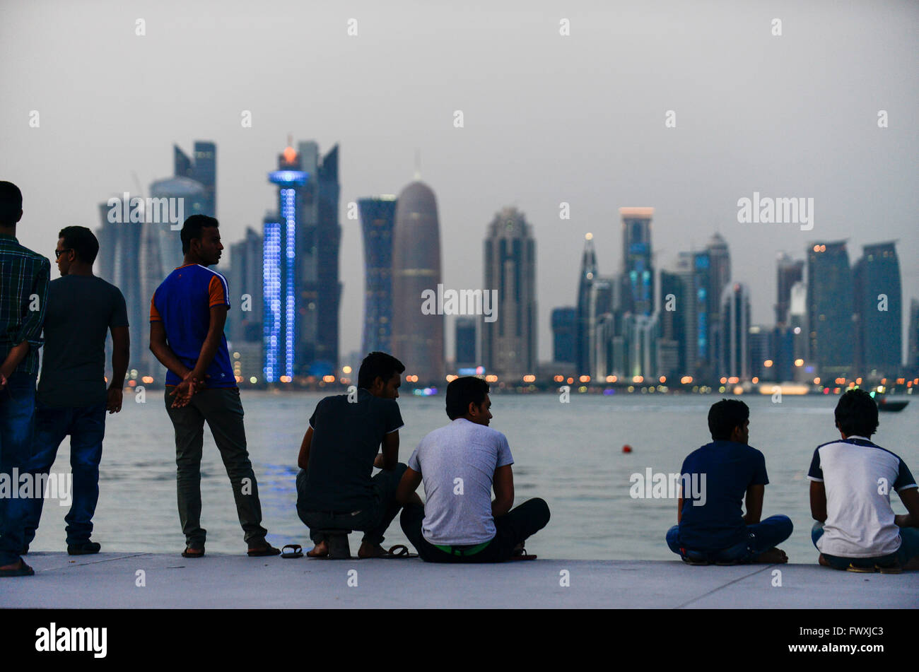 QATAR, Doha, skyscraper east bay, migrant worker on their holiday on friday at sea front corniche / KATAR, Doha, - Stock Image
