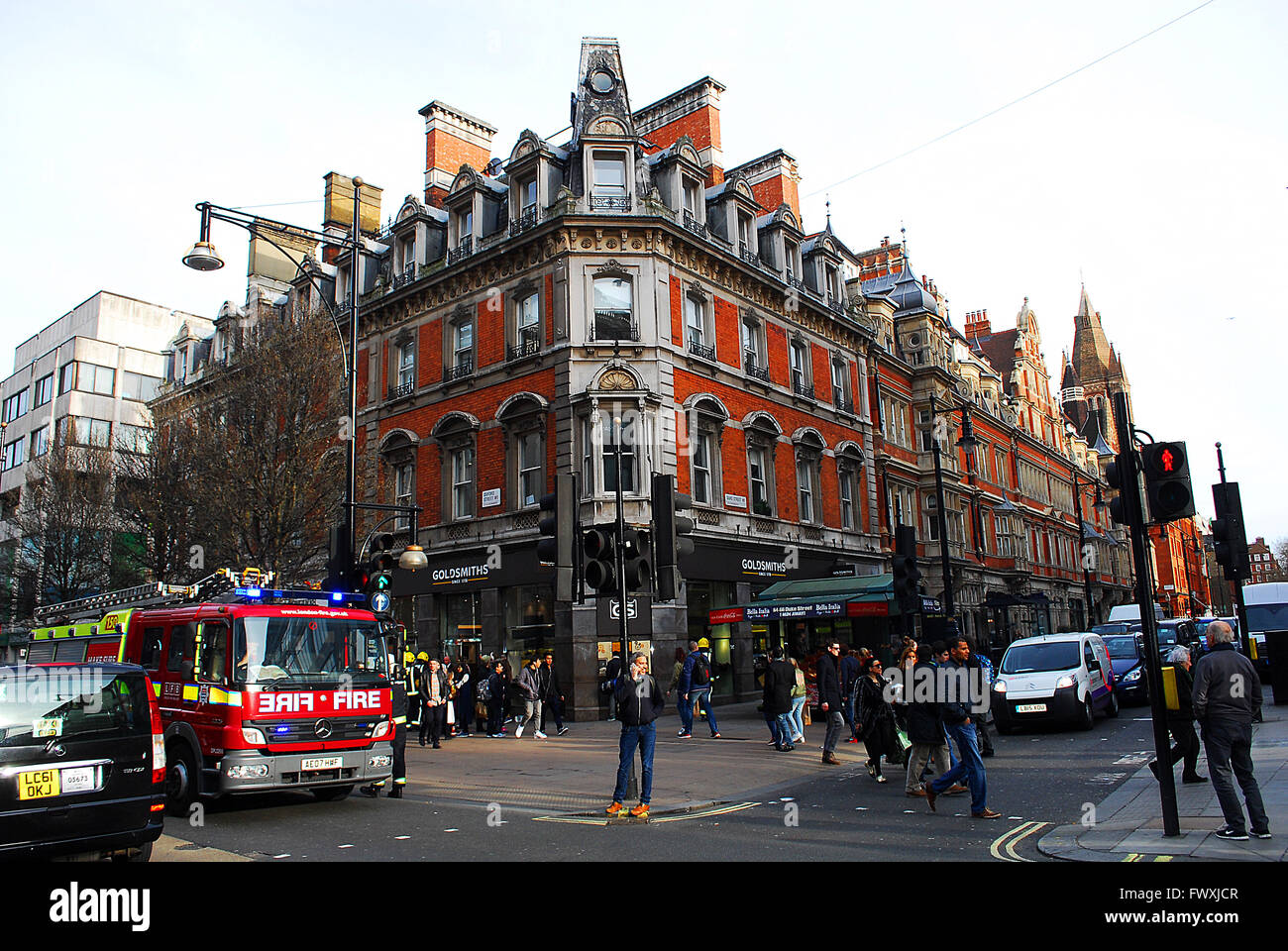 London Fire Brigade in response to health and safety call dangling metal on a building rooftop 01 04 2016 in London - Stock Image
