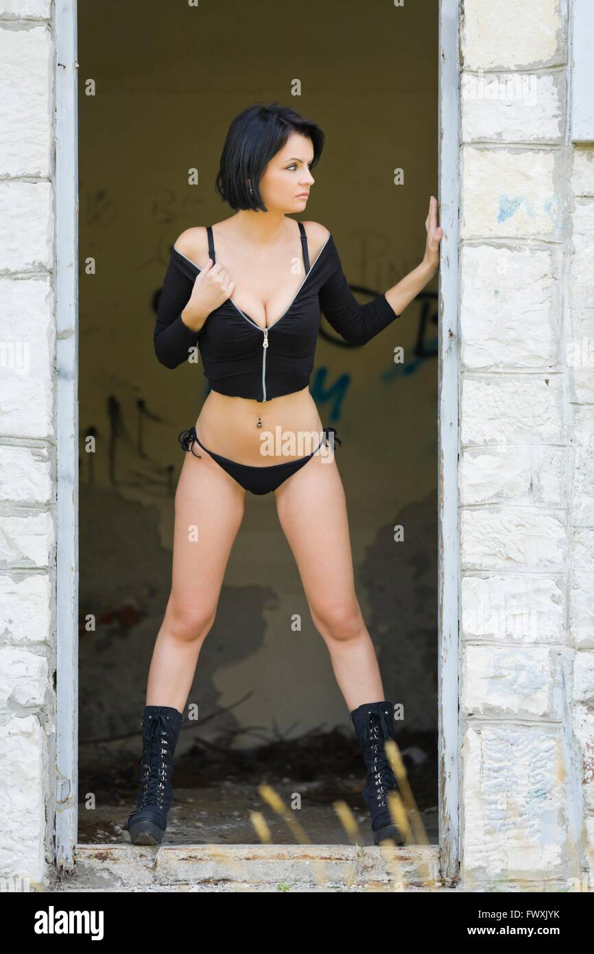 beautiful woman frameddoor entrance frame standing spread legs