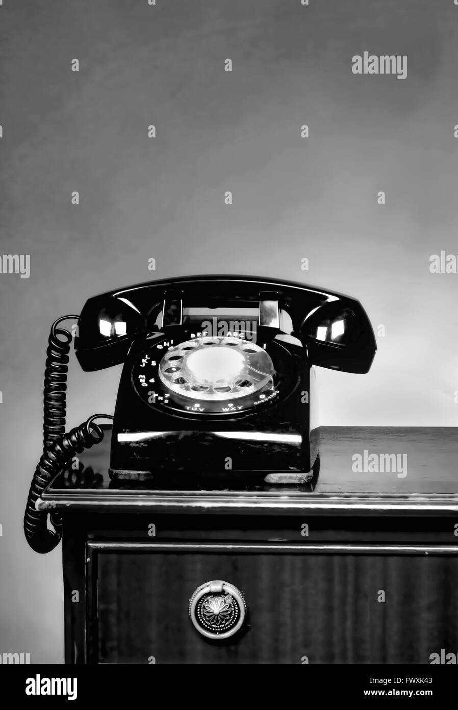 Old telephone with room for your type in black and white. - Stock Image
