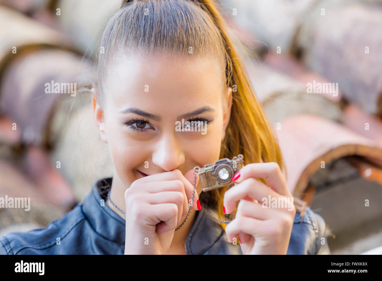 Tiny model camera and teen portrait outdoors ponytail pony-tail hair