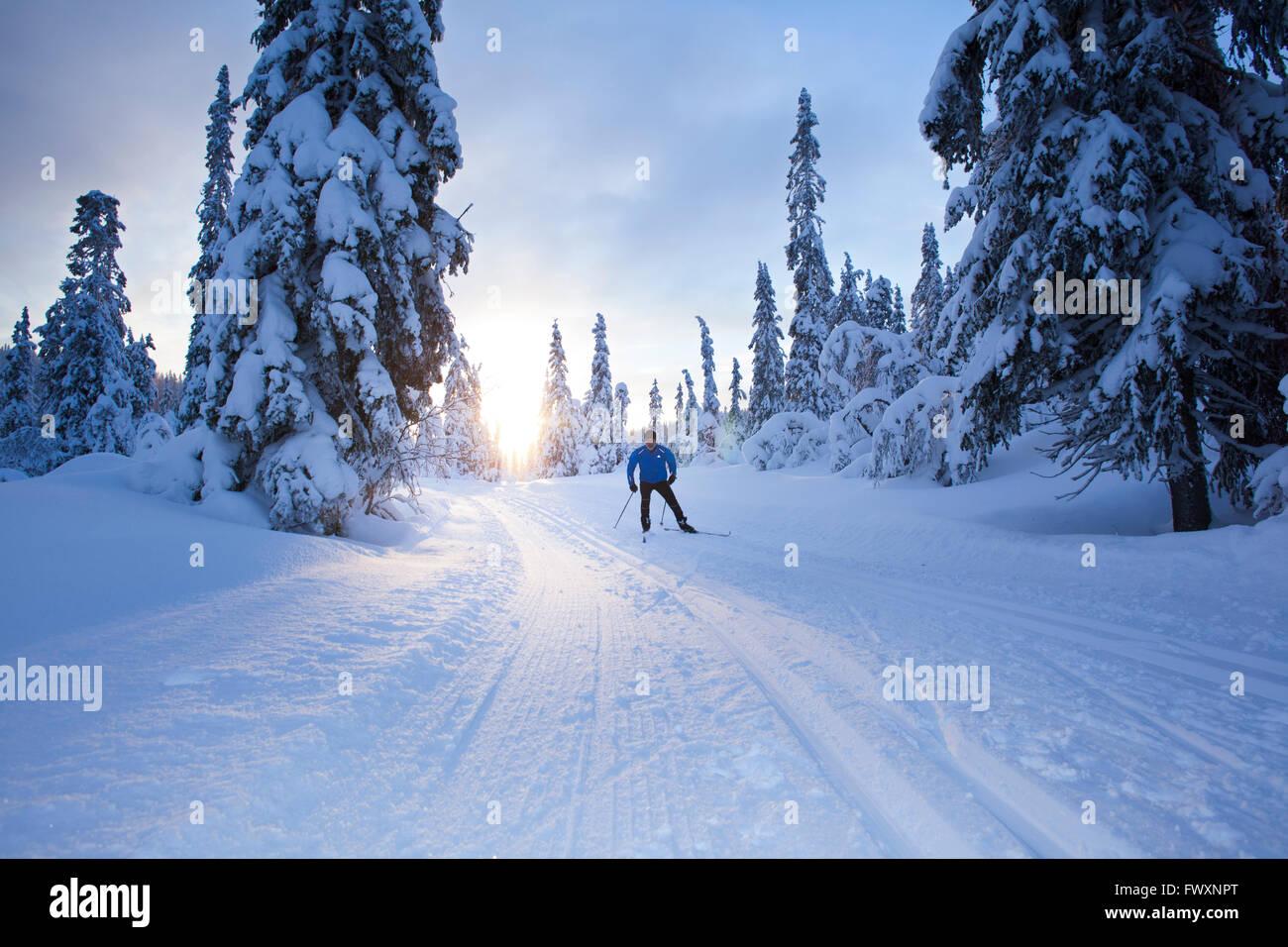 Sweden, Dalarna, Salen, Mature man cross-country skiing at dusk Stock Photo